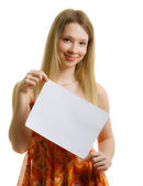Girl in a dress with a sheet of paper — Stock Photo