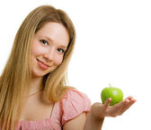 Girl with a green apple in her hand — Stock Photo