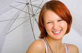 With a smile under an umbrella — Stock Photo