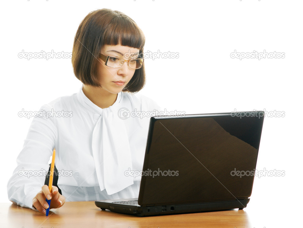 Serious woman in the office with the computer — Stock Photo #1323340