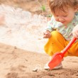 Girl playing in the sandbox — Stock Photo