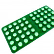 Green plate of tablets — Stock Photo