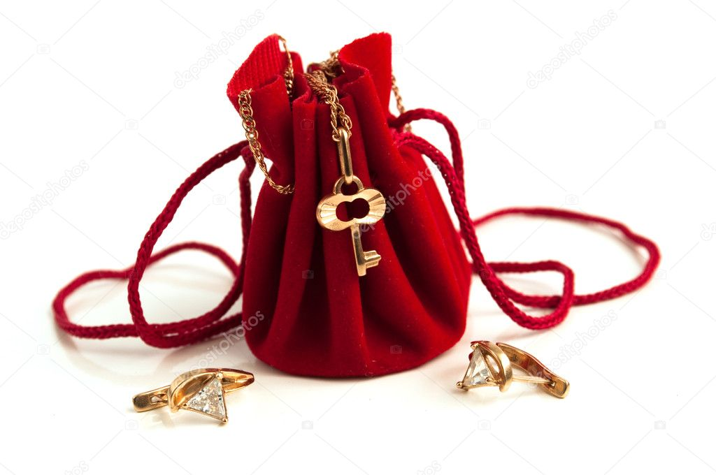 Gold chain with a key on a red small handbag — Stock Photo #2280457