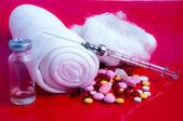 Multi-coloured tablets, syringe, gauze — Stock Photo