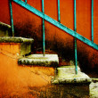 Old stairway on vintage red — Stock Photo