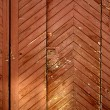 Vintage wooden door under the evening su — Stock Photo