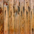Wooden fence with rusty nails — Stock Photo