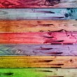 Colorful wooden fence with rusty nails — Stock Photo