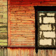 Vintage wooden wall with a stone window — Stock Photo