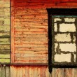 Vintage wooden wall with a stone window — Stock Photo #1248433