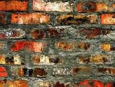 Colorful burnt brick wall background — Stock Photo