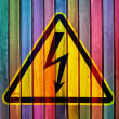 Stock Photo: High voltage on colorful wooden wall