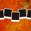 Five blank photos on grunge red acid bac — Stock Photo