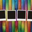 Four blank photos on colorful wooden bac — Stock Photo