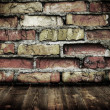 Room with cracked vintage brick wall — Stock Photo