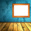Vintage blue room with blank frame — Stock Photo