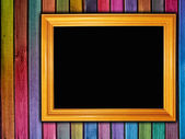 Colorful wooden wall with a frame — Stock Photo