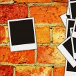Brick wall with blank photos on it - Stock Photo