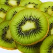 Fresh juicy kiwi background - Stock Photo