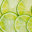 Juicy lime background — Stock Photo