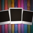 Wall with three blank photos on it — Stock Photo