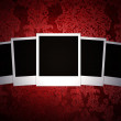 Blank photos on beautiful red background — Stock Photo