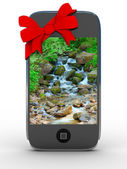 Phone in gift on white background — Stock Photo