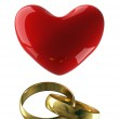 Heart with wedding rings on a white — Stock Photo