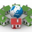 Houses standing around globe — Stock Photo