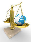 Cashes and the globe on scales — Stockfoto