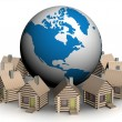 Wooden small houses round globe - Stock Photo