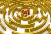 Gold labyrinth with a prize. 3D image. — Stock Photo