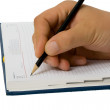 Hand writing to a notebook — Stock Photo