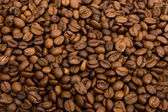 Roasted grains of fragrant black coffee — Stock Photo