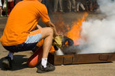 The fireman extinguishes foam fire — Stock Photo