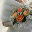 Wedding bouquet in hands of bride — Stock Photo