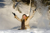 Young girl on nature throwing snow — Stock Photo