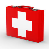 Red suitcase with white cross — Stock Photo