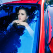 Woman in red car — Stockfoto