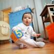 Stock Photo: Adorable infant plays in room, soft
