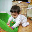 Adorable baby plays on floor, soft focus — Stockfoto