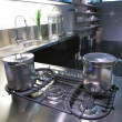 Modern kitchen with saucepan - Stock Photo