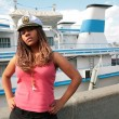 Stockfoto: Serious girl in captain cap