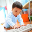 Little boy with keyboard, soft focus — Stockfoto