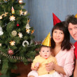 Happy family on New year holiday - Stock Photo