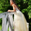 Beautiful bride on the wooden bridge — Stock Photo