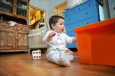 Baby plays in the room, soft focus — Stok fotoğraf
