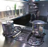 Modern kitchen with saucepan — Stock Photo