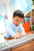 Little boy with keyboard, soft focus — Stok fotoğraf