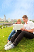 Pretty blond, yong man and laptop — Stock Photo